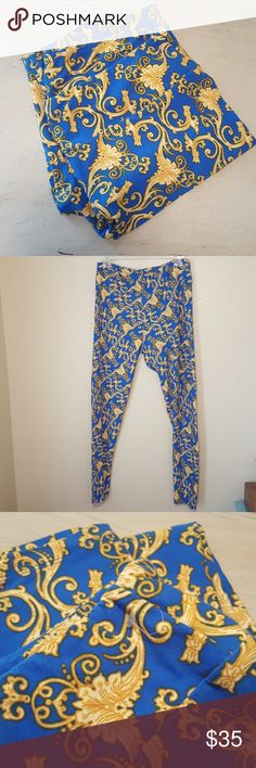 Lularoe tall and curvy leggings blue yellow NWOT Teeth lularoe leggings are new without tag. The plastic hang tag is still attached just not the lularoe label tag. Size tall and curvy. Beautiful bright blue with yellow filigree pattern. LuLaRoe Pants Leggings