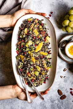 This cold wild rice salad is tossed in an orange vinaigrette, with crunchy pecans, and sweet cranberries and grapes. It's a perfect salad for Thanksgiving, and can be made ahead of time for a fast and easy holiday meal loaded with fall flavors. Wild Rice Recipes, Rice Salad Recipes, Healthy Salad Recipes, Vegetarian Recipes, Easy Holiday Recipes, Thanksgiving Recipes, Easy Recipes, Arroz Risotto, Wild Rice Salad