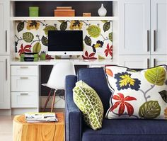 Matching fabric on workstation bulletin board and accent pillows