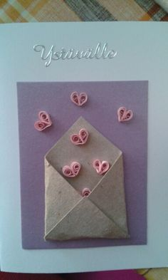 Envelope full of hearts by quilling
