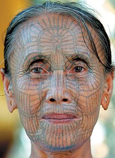 Face of a Chin woman with old style tattoos, Burma (Myanmar.