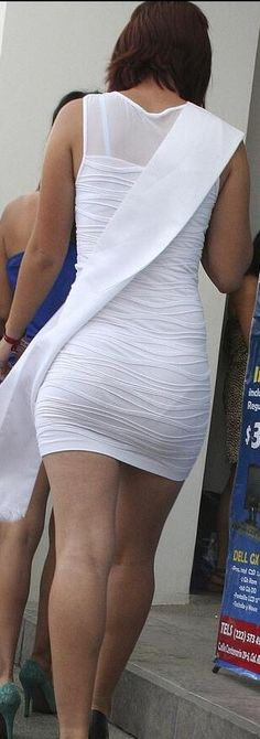 Visible panty line with the bonus of visible bra straps, in a tight white dress.