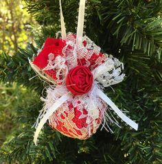 Red and ivory lace Christmas ornament, first Christmas, wedding gift, vintage Christmas, shabby chic Christmas decor, victorian Christmas by sunshowerflowers on Etsy https://www.etsy.com/listing/253185240/red-and-ivory-lace-christmas-ornament