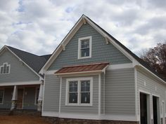 Swhite's house - planks are BM boothbay gray, shingle color is BM Puritan Gray