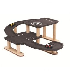 My First Garage Plan Toys Children- A large selection of Toys and Hobbies on Smallable, the Family Concept Store - More than 600 brands. Wooden Car, Wooden Toys, Wooden Toy Garage, Station Essence, Wood Packaging, Plan Toys, Rubber Tree, Eco Friendly Toys, Wood Tree