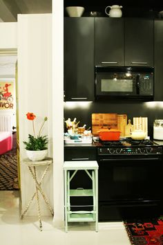 dark kitchen, pops of color. love the stool