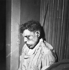 Unknown Buchenwald concentration camp guard, beaten and hanged by the prisoners upon liberation of camp. One of the few who got what he deserved. The picture was taken by the American military photographer Elizabeth Miller.