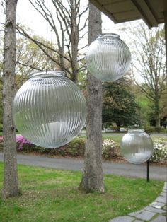 Love these so much. Ceiling fan globes turned into lanterns for the patio. on YHL