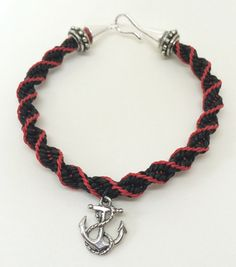 "Captain Killian ""Hook"" Jones bracelet done in black leather and red c-Lon cord with a silver hook clasp and anchor charm."