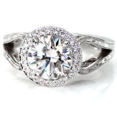 This regal design is breathtaking with a 1.50 carat round brilliant cut center diamond.#engagement #wedding #ring http://www.knoxjewelers.biz/products/design-2827