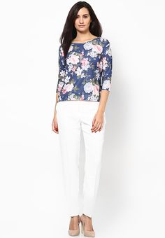 For women who like to experiment with a fresh style, this blue coloured top from Dorothy Perkins is a perfect buy. Featuring a bold floral print, this top will certainly become your favourite in just no time. Team this 100% cotton top with pants for a chic look.