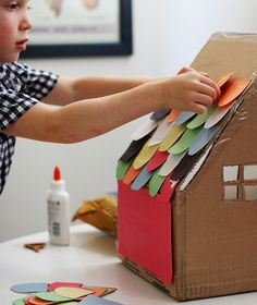 Making a cardboard box house. #kids #rainyday