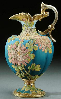 A NIPPON CORALENE DECORATED PORCELAIN BOLTED JUG CIRCA 1909 WITH BEADED GLASS DECORATION OF CARNATIONS ON A SHADED BK=LUESATIN GROUND