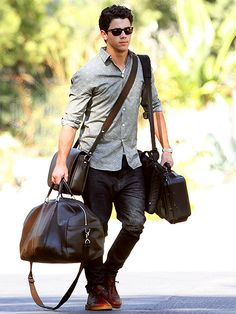 Nick Jonas carrying his own luggage after a problem with his roadie