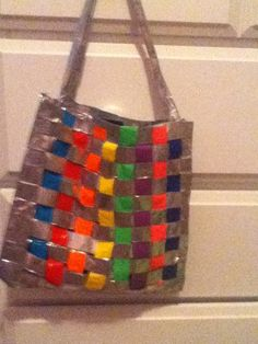 WEAVED DUCK TAPE PURSE!!!! this was really fun to make i weaved it its silver and rainbow its a really good size it does have a strap. its hard to make but its worth it after all of your hard work!
