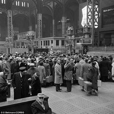 24 Dec 1960: Many people at Penn Station, New York City.