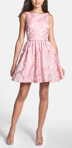 This adorable pink dress would look great with a fitted blazer for the office