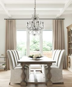 Glamorous neutral living room design with stunning chandelier | Kelly Deck Design