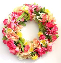 String faux flowers onto a wire dry-clean hanger to make a fluffy spring wreath. 42 Dollar Store Tricks Every Broke Person Should Know Fake Flowers, Diy Flowers, Flower Pots, Beautiful Flowers, Cheap Flowers, Flower Crafts, Flower Bouquets, Pom Pom Wreath, Diy Wreath