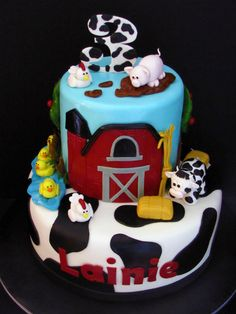 This two tier farm animal cake is covered in marshmallow fondant. The animals and the number 3 are made out of gumpaste. Farm Birthday Cakes, Animal Birthday Cakes, Cow Birthday, Birthday Ideas, Barnyard Cake, Farm Cake, Barnyard Party, Cow Cakes, Cupcake Cakes