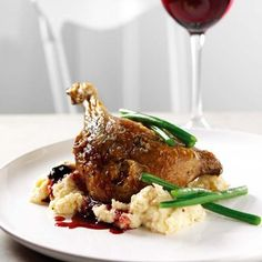 Confit of duck recipe, with a dark cherry glaze, served on a bed of celeriac mash. | Red Online