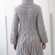 Minimissimi Sweater knitting pattern by Minimi Knit Design - This sweater coat is worked from the top down. The cables are carefully arranged to give a slimming silhouette without adding extra bulk.Measurements are given in both centimeters and inches.The yoke and the cables are charted only. Each size has its own set of charts, which are printed full size for easy reading. Download at LoveKnitting