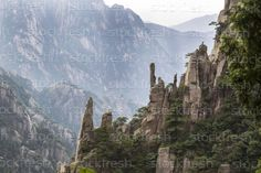 Large Vertical Rocks in Yellow Mountain Valley stock photo © Thomas Baker ( Vertical Rock, Mountain Art, Spring Time, Cool Photos, Royalty Free Stock Photos, China, Sky, Culture, Mountains