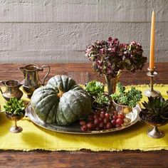 Succulents and silver go together beautifully on this Thanksgiving centerpiece. Details + more ideas for Thanksgiving centerpieces: http://www.midwestliving.com/homes/seasonal-decorating/holiday-ideas/easy-thanksgiving-centerpieces/page/24/0