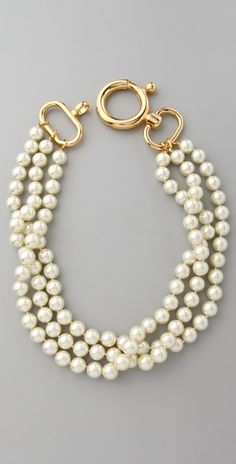 pearl necklace w interesting clasp.                                                                                                                                                                       Great closure on this handsome three strand necklace. $237, gold plate.
