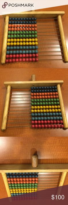 WW II 1940s PHILIPPINES ABACUS - 12 ROWS WOODEN WW II 1940s PHILIPPINES ABACUS - 12 ROWS OF 10 WOODEN COLORED BEADS, WOOD, METAL  MY FATHER BROUGHT THIS BACK HOME FROM PHILIPPINES DURING WORLD WAR II.  VINTAGE, COLLECTIBLE!!!  I PLAYED WITH THIS AS A CHILD IN THE 1950s!!!  IT HAS COLORED BEADS OF MEDIUM BLUE, ORANGE, GREEN, YELLOW, LIGHTER BLUE, RED - 2 ROWS OF EACH COLOR.  MOVE BEADS FROM LEFT TO RIGHT ALONG THE METAL RODS TO DO ARITHMETIC!!!  GOOD CONDITION - BUT IT IS USED!!!  COMES FROM…
