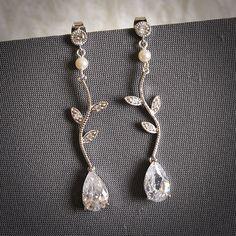 CAISSIE, Modern Vintage Inspired Spiral Leaf Rhinestone Bridal Earrings, Swarovski Crystal and Pearl Wedding Earrings, Art Deco Jewelry. $59.00, via Etsy.