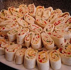 Tortilla Pinwheel Appetizers 10 large flour tortillas 1 cup chopped veggies - I like using red and green peppers, red onion, and celery. 1.5 blocks cream cheese, softened 1 package dry ranch dressing mix 1/4 cup salsa 1/2 cup shredded cheddar cheese