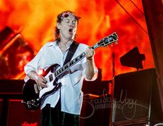 AC/DCs Angus Young performing for Detroit at the Lions Ford Field in the summer of 2015 on the Rock Or Bust Tour.  Photo taken, edited and printed by me!  8.5 x 11 fine art color print on glossy finish photo paper (Also available at 13x19).  The print has a .25 inch white border and is signed by the photographer, ready for framing. Frame NOT included and watermark is for online display only.  Visit me on: INSTAGRAM: www.instagram.com/BrandonDaArtist FLICKR: www.flickr.com/brand...