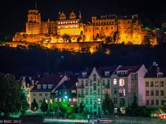 The fabulous Castle in lights at night on the hillside over Heidelberg, Germany.