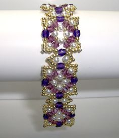 I have used purple czech purple firepolish facet beads, czech amethyst bicones, acyrlic white pearls and metallic gold seed beads. The bracelet is finished with a gold plated toggle clasp. The acrylic pearls are 3mm and the bicones and facets are all 4 mm.  Length of bracelet including clasp is 21 cm (8.2 inches) and width is 2 cm (0.9 inches) which is comfortable for a 7 inch wrist