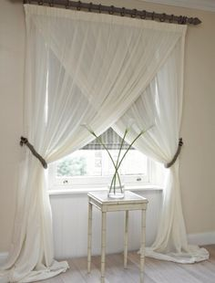 Swap traditional nets for voile- absolutely adore this idea gives it an peaceful elegance feel to the  room