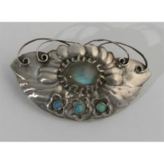 A georg jensen silver and moonstone brooch cast in low relief with flowers Wallis, It Cast, Brooch, Flowers, Silver, Rings, Money, Brooches, Florals