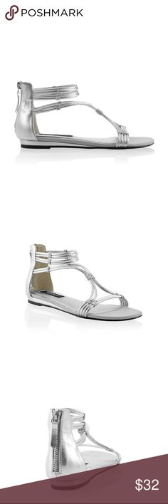 """BRAND NEW WHBM SILVER GLADIATOR SANDALS BRAND NEW NEVER WORN Silver Gladiator Sandals Get strapped in style with shimmering comfort— metallic silver gladiator sandal with zip back closure and slight wedge heel for stunning strides day in and day out. Breathable lining. Super-comfortable memory foam footbed. Textile outsole. Genuine leather and manmade materials. 0.5"""" silver wedge. Comes with original WHBM shoe box. White House Black Market Shoes"""
