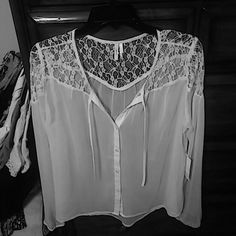 "New Listing Frenchi White Button Down Blouse NWT This is a gorgeous sheer white blouse with long sleeves, elastic cuff at wrists. Sheer beautiful lace at the top of blouse. Ties at neckline. I wish it for me but it's too tight for the girls. It's a bit longer in back. Measures 20"" across bust, shoulder to bottom is 24"" in front & 26"" in back, sleeve 24"" long. Definitely needs a cami under it unless of course you may want to use it over a bathing suit if your short. Frenchi Tops Blouses"