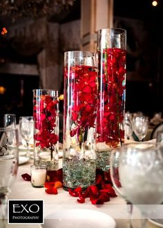 See more about wedding reception centerpieces, wedding centerpieces and red centerpieces. Table Decoration Wedding, Red Wedding Centerpieces, Winter Centerpieces, Flower Centerpieces, Centerpiece Ideas, Church Decorations, Red Table Decorations, Modern Centerpieces, Tall Centerpiece