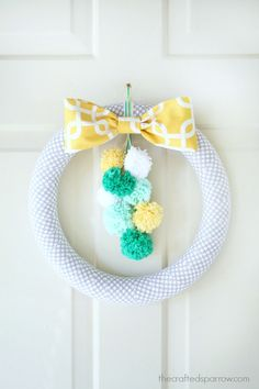 Pom-Pom-Spring-Wreath. I think this would be cute in red, green and white for Christmas.