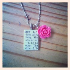 a word from a vintage dictionary coupled with a pink flower charm make the perfect pendant necklace!