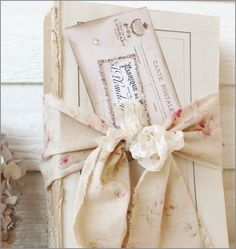 Old book, antique postcard...great shabby chic look for end table.