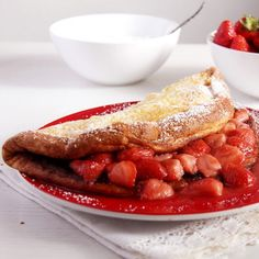 An amazingly fluffy and comforting pancake served with a deliciously aromatic warm strawberry sauce.