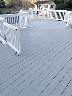 Cabot Seacoast Gray solid stain. Love this color! It's on our deck and I spent a lot of time to find the right color. It's not too bright in sun light. In real it's a tiny bit less blue than on this picture. A very distinguish gray/beige with a hint of porcelain blue.