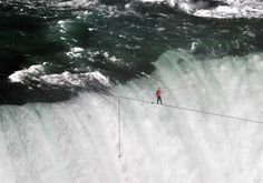 "Nik Wallenda, a member of the famed ""Flying Wallendas"" family of aerialists, completed a historic tightrope crossing through the mist over Niagara Falls Gorge on Friday, stepping from a two-inch (5 cm) cable onto safe ground in Canada to wild cheers from onlookers.    Read more: http://nbcnews.to/MQlg1G"