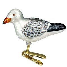 """Might need a couple of these on my beach tree this year. Sea Gull Christmas Ornament 18037 Merck Family's Old World Christmas Measures approximately 2 3/4"""" Mouth blown, hand painted, glass Christmas ornament from Merck Family's Old World"""