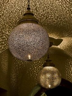 brass Moroccan pendant chandelier that casts tiny flecks of light all over a room - $800... must find a way to DIY it!