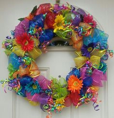 Festive colors used on this Wreath. Can be used all summer long