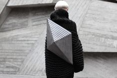 """Guided by a quote from Marcel Proust saying """"The real voyage of discovery consists not in seeking new lands but seeing with new eyes"""", the creator Konstantin Kofta made these two collections of original bags, """"Inertia"""" and """"Platonic Solids"""". Futuristic bags made of geometric and organic structures, neutral colors and delicate textures."""